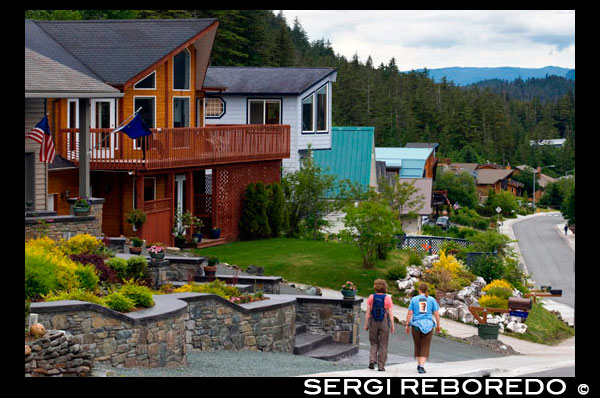 Modern wooden houses in a residential suburb of Douglas area,  Juneau. ALASKA, USA.  The Douglas area of Juneau is located on Douglas Island and is linked to downtown Juneau by bridge. You'll find that a lot homes for sale in Douglas, AK have great views of the Downtown area, Mount Juneau, Mount Roberts and up and down the Gastineau Channel. Douglas began life as a mining community and was once a city on it's own, rivaling Juneau. After the mine collapsed, in the early part of the last century, a gradual decline in population began and in the 1970's, the community decided to merge with the city of Juneau. Now it is a popular residential area, just 10 minutes from Downtown.