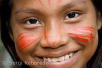 Yagua town. A traditionally painted teen poses for the camera.