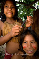 Yagua town. A painted girls pose for the camera.