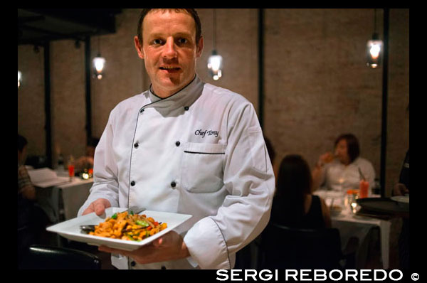 Chef Tony from Sala Rattanakosin Hotel in Bangkok. Thailand. Asia. Sala Rattanakosin restaurant and bar, sala rattanakosin's restaurant, is a scenic, riverfront dining option, overlooking the legendary chao phraya river and the mystical temple of dawn. Sala Rattanakosin bangkok also features the roof, this rooftop bar and terrace in bangkok provides idyllic riverfront setting to relax with a cold beverage at the end of a wonderful sightseeing day. At Sala Rattanakosin, we make sure that guests will have a memorable experience as they enjoy our wine bar and restaurant in bangkok. THE ROOF. chic open-air rooftop bar and lounge, with stunning views of the chao phraya river, temple of the dawn (wat arun) and other historical sites. serving beer, cocktails, wines and light snacks daily. A scenic, riverfront restaurant, overlooking the chao phraya river and the temple of the dawn (wat arun). the two storey restaurant offers indoor seating and an outdoor over water dining deck, serving a variety of delectable international dishes and a diverse selection of traditional thai favourites. the river bar features a variety of worldly wines, beers and cocktails, and has become one of bangkok's most romantic and iconic dining experiences.