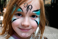 A child with painted face in St George's Market. In addition to these local delicacies, there is also a fusion of tempting continental and speciality foods from around the world. Included are such delights as wild boar, cured meats, venison, Spanish tapas, Caribbean foods, Mexican and Slavonic foods, continental coffees and teas, Italian olive oils with traditional French Crepes and extraordinary French pastries to mention just a few. Added to this plethora of tempting foods the Saturday market also encompasses flower stalls ensuring this Saturday market is a kaleidoscope of colour.  St. Georges City Food & Garden Market is more than just a shopping experience. Customers can sample the produce, relax with a coffee and a newspaper against a backdrop of live jazz or flamenco music. This market is a real Saturday treat and a great outing for all the family. In a survey published by The Guardian newspaper's travel section in January 2010, St. George's Market came sixth in the UK 'top ten'.**  Transport A free market bus runs every 20 minutes between the City Centre (outside Boots the Chemist, Donegall Place or HMV, Castle Place) and the market. Bus departs 8.00am on Friday and every 20 minutes thereafter. Bus departs 9.00am on Saturday and every 20 minutes thereafter.  Nearest customer parking at Hilton car park opposite the market. For more information on trading at St Georges market or hiring St Georges Market please visit http://www.belfastcity.gov.uk/stgeorgesmarket/index.asp