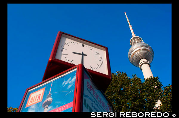 Television tower and world clock at Alexanderplatz in Berlin. Everyone is supposed to remember that Berlin's Fernsehturm (TV Tower) is 365m high and is the tallest building in Berlin. As urban legend has it, the tower's height was a deliberate decision taken by Walter Ulbricht, Leader of the SED, so that every child would be able to remember it, just like the days of the year. In fact the tower's summit today is 368m.  Construction for the GDR transmitter started in the 1950s and the tower erected between 1965-69 was intended as the tallest tower in Europe second only to Moscow's own TV tower. It was built by East German architects Fritz Dieter, Günter Franke and Werner Ahrendt.  A separate TV broadcasting system for East Berlin was a necessity during the years of division and the fact that it was built right in the middle of the city was Ulbricht's original vision. It remains the only city TV tower in Europe. An extremely popular sight for tourists and Berliners alike, it currently receives over 1 million visitors a year. The lift reaches an altitude of 200m in 40 seconds; the observation deck is at a height of 203m and the Telecafé at 207m. The Telecafé, designed with an outer ring of revolving tables, serves coffee, snacks and reasonably priced meals while revolving once around its axis every 30 minutes. On a bright day, this is the way to take in Berlin and surrounding Brandenburg from an eagle-eyed view.