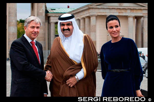Berlin Major Klaus Wowereit (C), accompanies the Emir of Qatar, Hamad bin Khalifa Al Thani (L), and his wife Mozah Binti Nasser Al Missned (R), to the landmark Brandenburg Gate in Berlin, Germany. Qatar celebrates its National Day in commemoration of the historic day in 1878 when Shaikh Jasim succeeded his father, Shaikh Muhammad Bin Thani, as a ruler and led the country towards unity. The event on December 18 is considered as an opportunity for all Qatari nationals and expatriates to recognise and celebrate what it means to live in modem day Qatar.  Qatar is a peninsula of 11.521 sq km located half way down the west coast of the Arabian Gulf enveloped by water from almost all sides. The country is centrally placed among the states of the Gulf Cooperation Council (GCC). It is neighboured by Saudi Arabia and UAE from the south and by Bahrain from the north-west. Qatar is considered as an ideal gate to the Arabian Gulf due to its unique historical monuments and its beautiful scenery, in addition to the high quality architecture, sports, shopping, restaurants and living compartments.  The state of Qatar with a population of 1,677,045, is a land of astonishing natural beauty and cultural prosperity, it is considered to have some of the most beautiful landscape in the Arabian Peninsula. The country's geographic location had a major influence on its politics, strategic options and development. Although the country is small in size yet it is big in value, it has achieved in decades what takes centuries for other countries to achieve. Its citizens hold an optimistic future and potentials that others can only envy. Qatar's history extends to more than four thousand years; it tells stories of heroism, great courage, wisdom, patriotism, love and devotion to homeland. This brings closer understanding to the richness of the Qatari cultural experience, which has contributed, to the building of modern Qatar.  Since His Highness Sheikh Hamad Bin Khalifa Al-Thani ascended the throne in 1995, the country has achieved high level of economic growth and development. It enjoys a strong and firm economy, helped by its vast oil and natural gas reserves, which forms the mainstay of the Qatar economy. Even though total oil reserves are somewhat modest in comparison to other Arabian Gulf countries, Qatar is one of the leading natural-gas producers in the world. It produces natural gas, crude oil, refined petroleum, and petrochemicals, in addition to steel, cement, and fertilisers.  Qatar has become an important centre for global companies and agencies, which started opening branches in Qatar due to its unique and profitable location to invest, and market products, therefore it can be said that Qatar has become a key player in the business world, especially in the Gulf region. Qatar's government and people are also working hard in diversifying its economy away from oil and gas, and there has been strong growth in tourism, IT and the knowledge-based economy in recent years, and despite the implications of the global financial crisis, the economic performance of the state of Qatar has been a source of appreciations by a number of financial institutions all over the world. Education and health sectors have played and still playing an important role in building the Qatar citizens. The number of schools avails high quality health and education care free of charge to all Qataris. Qatar's education infrastructure has grown dramatically in recent years thanks to the country's rapid economic growth. In addition, Qatar has high quality health care system, which won the praise of Unicef and WHO.  Qatar is fast developing as a major Mid-east destination, after opening its doors to tourism. It houses major historic forts, modem luxury hotels, and impressive seascapes. Tourists can explore the natural environment of Qatar by taking an exciting desert safari. There is something for everyone in this land of great natural beauty. As for sports, being recently chosen by the FIFA to host the 2022 World Cup, Qatar becomes the first ever Muslim and Arab country to host the world's greatest football event. The decision shows that the Arab countries are capable of organising major international events and serves as an opportunity to promote and portray the accurate image of the Islamic culture. It is also a glorious chance for the Arab football teams to make their presence felt in the tournament. On the other hand, Qatar plans to achieve another impressive success when it hosts the 2011 AFC Asian Cup, after the resounding success of the XV Asian Games 2006 in Doha.