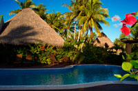 Aitutaki. Cook Island. Polynesia. South Pacific Ocean. Swimming pool of Aitutaki Lagoon Resort & Spa Hotel. Right beside the Activities Hut is the waterfalls swimming pool. Which is handy, as that's also right beside Aroa Beach. And because The Rarotongan is luckily located right on the sunshine southwest coast, this means there's sunshine all day on the freshwater pool, the beach, and the lagoon – right up until sunset that is (often a glorious, blazing island sunset). There's plenty of comfortable pool loungers to enjoy, so grab your complimentary pool / beach towel from the Activities Hut and make yourself comfortable for another day in Paradise. After you've soaked up some rays, take a cool dip in the pool. Someone's gotta do it. The sublime Aitutaki Lagoon Resort & Spa rests effortlessly on its own secluded, private island of Motu Akitua - the only private island resort in the Cook Islands. Just a 2 minute ride from the main island of Aitutaki by small private ferry, the isle of Motu Akitua is encircled by broad, expansive beaches the colour of champagne. From here, you as our guest are able to enjoy the only resort facing directly onto the world's most beautiful lagoon, and from here, you can drink in spell-binding views of one of the Wonders of the World to your heart's deep content. Nothing will prepare you for the intensity, the vibrancy, the omniscience, of the lagoon's blue expanse. So intense, so expansive, it is not just a colour you see, it is a blue you feel with every fibre of your being. This is the reason you have journeyed all the way across the oceans, to see, to feel, to truly experience the world's most beautiful lagoon. Staying at The Aitutaki Lagoon Resort & Spa, you will have the opportunity not just to see Aitutaki Lagoon as a day tourist might, but to really experience this true Wonder of the World in all its moods.