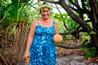"Aitutaki. Cook Island. Polynesia. South Pacific Ocean. In a makeshift beachside restaurant delights are prepared with coconut flavor.  Maina is one of 22 islands in the Aitutaki atoll of the Cook Islands. It is located at the southwestern extreme of Aitutaki Lagoon, five kilometres to the southwest of the main island of Aitutaki. In front of Maina island stands the beautiful sandbar known as ""Honeymoon Island"" named after a Canadian couple who decided to get married here.The sand is incredibly white and the water is transparent blue. The sandbar is also home (for a few months a year) of a rare single red feather bird who comes on the island to lay eggs. Aitutaki island is a combination of high island and coral atoll formed from a volcanic eruption on the sea bed, 5 kilometres below the surface of the South Pacific ocean. It is a similar type to Bora Bora in French Polynesia. After Aitutaki rose above the ocean surface, coral formed on the shores of this ""high island"" (Like Rarotonga is today).  Weathering eroded much of the basalt rock but the reef kept building vertically from it's original position, leaving the Aitutaki lagoon between the reef and the remaining basaltic parts of the main island of Aitutaki. The islets of Motu Rapota and Motu Rakau which lie inside the Aitutaki lagoon are blow holes from the main volcano – Maungapu - and lava tunnels run from this mountain underneath the lagoon to those small islands."