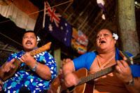 Atiu Island. Cook Island. Polynesia. South Pacific Ocean. Dances and Polynesian dances organized at Hotel Villas Atiu Atiu island.  The music of the Cook Islands is diverse. Christian music is extremely popular. Imene tuki is a form of unaccompanied vocal music known for a uniquely Polynesian drop in pitch at the end of the phrases, as well as staccato rhythmic outbursts of nonsensical syllables (tuki). The word 'imene' is derived from the English word 'hymn' (see Tahitian: 'himene' - Tahiti was first colonised by the English). Likewise the harmonies and tune characteristics / 'strophe patterns' of much of the music of Polynesia is western in style and derived originally from missionary influence via hymns and other church music. One unique quality of Polynesian music (it has become almost a cliché) is the use of the sustained 6th chord in vocal music, though typically the 6th chord is not used in religious music. Traditional songs and hymns are referred to as imene metua (lit. hymn of the parent/ancestor).