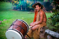 "Rarotonga Island. Cook Island. Polynesia. South Pacific Ocean. Highland Paradise Cultural Village. Show in traditional Polynesian dress and drums.  Sometimes known as ""the lost village"" Highland Paradise is a cultural feast of Cook Islands entertainment and spiritual experiences. Wednesday and Friday sunset cultural nights and daily guided tours. AUTHENTIC AND AWARD WINNING! Weekday Guided tours of authentic historical sites in this mountain village refuge that lay forgotten for 150 years include re-enactments, interactive live days, restored maraes and faithfully rebuilt traditional buildings all recreating the ambience and spirituality of this sacred place where our ancestors lived, loved, fought and died. You will learn of our proud and sometimes, sad and sordid history. Amongst 25 developed acres of magnificent gardens and views you will experience drumming, singing, dancing, weaving, carving, medicine making, story telling and umu feasting just as they were more than 600 years ago on this very spot! The multi award winning, Wednesday and Friday sunset cultural nights, include hosted roundtrip transport, expert guides, village cultural immersion experiences, marae visit, a tapu lifting, warrior welcome, cocktail, underground oven (umu) feasting like you have never experienced and spectacular stage show telling the story of our ancient heritage through singing, dancing and drumming."
