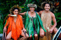 Rarotonga Island. Cook Island. Polynesia. South Pacific Ocean. Highland Paradise Cultural Village. Some of the actors of Highland Paradise Cultural Village with polynesian dress. The unique Cook Islands culture is continually evolving and today you can discover it as it was in pre-missionary times. This tour is the perfect way to view the island and get an insight into the sacred rites and traditions of the forefathers of Rarotongans. Highland Paradise is a traditional Marae situated 509 metres above sea level and boasts approximately 205 acres of beautiful transcending gardens and panoramic views of the aqua lagoon, fringing coral reef and Pacific Ocean. This breathtaking site has been a haven for families, warriors and chiefs for centuries. The 'Are Kario', or Hall of Cultural Entertainment, has been designed to take advantage of the spectacular views and to offer shelter as you enjoy some of Rarotonga's top entertainment! The show's sensuous dancing and pounding drums are typical of the island and considered to be amongst the best in the South Seas.