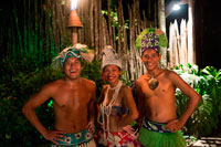 Rarotonga Island. Cook Island. Polynesia. South Pacific Ocean. Some participants in the the Highland Paradise Cultural Village show.  Dressed in traditional costumes of the Cook Island. Traditional dance is known as ura. Dancers move their bodies to express the stories of the islands, accompanied by singing and drumming. Ura began as a sacred ritual in Polynesia and has now become a popular dance form. Watch the hands as well as the hips and legs - different gestures symbolise different meanings. The dancers are telling stories of birds, flowers, the ocean and, of course, of love and loss, the sadness and joy of we humans. Distinctive to the sound of Cook Islands music is the full and resonating drumbeat. A typical Cook Islands drum team involves five or more drummers setting the tempo and directing the body and hand movements as well as the hip and leg motion. Cook Islands drums can be divided into three groups: wooden drums or slit gongs, skin or 'true' drums and specialised rhythm makers, which imitate or substitute drum rhythms. The drumming is some of the world's best. A typical drum team usually involves five or more drummers: a lead drummer (pate taki), support lead (pate takirua), a double player (tokere or pate akaoro) on wooden gongs, and two other players on skin drums (pa'u and mango).