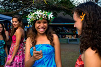 Rarotonga Island. Cook Island. Polynesia. Some nice teenagers dressed in Polynesian around the Punanga Nui Markets.  Cook Island market day is every Saturday down at the Punanga Nui Markets (located in Avarua, which the locals call Town) for locals and visitors alike. Locals tend to head to the markets early (before breakfast) to pick up bargains on fresh fruit and vegetables. Here local delicacies can be one third the price you will find them at the supermarket. Most visitors take a more leisurely approach and tend to get to the markets mid morning. To get there you can either catch the Island Bus to Avarua or drive. Parking space is easily found down at the eastern end of the market. At the eastern end of the market you will find an array of craft and clothing stalls selling colourful sundresses, pareu's, ukuleles, black pearls and jewellery. Be sure to look out for the Cook Islands tivaivai (quilts). They are beautifully handmade bedspreads of tropical designs and colours. The tivaivai art form is unique to the Cook Islands and are works of love by the women who spend hours making the sought after bedcovers.