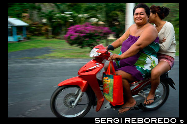 Rarotonga Island. Cook Island. Polynesia. South Pacific Ocean. Two obese people drive a motorcycle on a road on the island of Rarotonga.  Obesity in the Pacific is a growing health concern with health officials stating that it is one of the leading causes of preventable deaths in the Pacific Rim. According to Forbes, Pacific island nations and associated states make up the top seven on a 2007 list of fattest countries, and eight of the top ten. In all these cases, more than 70% of citizens age 15 and over have an unhealthy weight. Reasons for this issue include mining operations that have left not much arable land; as a result, much of the local diet is of processed, imported food such as Spam or corned beef, rather than fresh fish, fruit and vegetables. In addition, cultural factors have been blamed, such as associating a large body size with wealth and power, or changing ways of living, with children leading more sedentary lives. The problem is leading to increased levels of illness, including diabetes and heart diseases. In the Marshall Islands in 2008 there were 8,000 cases of diabetes in a population of only 53,000. In Fiji, strokes used to be rare in the under 50s, whilst doctors reported that they had become common amongst patients in their 20s and 30s. The problems are not confined to the small island nations, with the United States appearing 9th on the list, New Zealand 17th, and Australia 21st. In Australia, ambulances have been redesigned and equipped with heavier stretchers and larger wheelchairs to take account of the increased weight of the patients they carry.