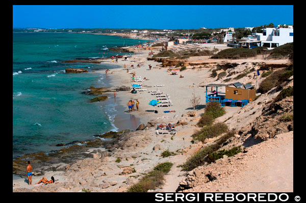 Migjorn beach, Formentera, Balears Islands, Spain. Hotel Riu la Mola. Holiday makers, tourists, Platja de Migjorn, beach, Formentera, Pityuses, Balearic Islands, Spain, Europe. Spain; Formentera; Migjorn; beach; island; balearic; mitjorn; Baleares; atrraction; destination; Europe; sand; European; holiday; travel; islands; mediterranean; photos; place; spanish; sun; beaches; break; calm; clear; coast; color; colour; dawn; day; daybreak; destination; dune; early; flat; formentera; holiday; horizon; horizontal; island; islas; mitjorn; landscape; mediterranean; migjorn; mist; bodies; body; busy; coast; coastline; coastlines; coasts; crowded; day; daylight; daytime; de; during; europe; european; outside; morning; pitiuses; sandy; scene; sea; south; spain; summer; vacation; view; wave; waves; tourism; touristic; vacation; view; Balearics; beautiful; beauty; paradise; fun; happy; coastal; paradisiac; popular