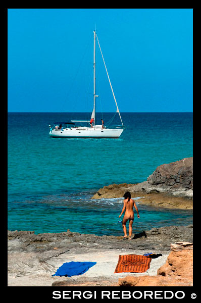 Nude woman in Es Calo beach, Formentera Island, Mediterranean sea, Balearic Islands, Spain. Es Calo de San Agusti with boat in Formentera island turquoise mediterranean.  Spain; Formentera; island; agusti; background; balearic; Es Calo; nice; atractive; woman; girl; pretty; beauty; calo; beach; beautiful; beauty; blue; boat; calo; coast; es; escalo; europe; formentera; holiday; ibiza; idyllic; isla; island; islands; islet; landmark; landscape; mediterranean; nature; ocean; outdoor; paradise; places; rock; rocky; san; scenic; sea; seascape; shallow; shore; sky; spain; stones; summer; adult; alone; balearic; bare; beach; body; bottom; bum; butt; female; foot; formentera; full; holiday; horizon; islands; length; look; med; mediterranean europe; migjorn; mitjorn; naked; naturist; nude; nudes; nudist; one; out; person; platge; platja; playa; rear; rocks; rocky; rough; sand; sandy; sea; single; slim; spain; spanish; stand; summer; tourism; travel; vacation; view; watch; wave; woman; sun; sunny; touristic; transparent; travel; turquoise; vacation; water; waves; white; balearic; Baleares; atrraction; destination; Europe; European; holiday; travel; islands; mediterranean; photos; place; spanish; sun; tourism; touristic; vacation; view; Balearics; beautiful; beauty; paradise; fun; happy; coastal; paradisiac; popular