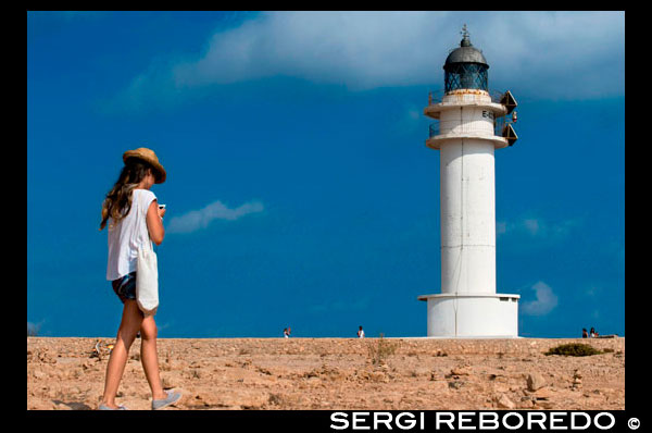 Es Cap de Barbaria lighthouse, in Formentera, Balears Islands. Spain. Barbaria cape formentera lighthouse road.  Spain; Formentera; island; Barbaria; lighthouse; day; romatic; balears islands; couple; es cap de barbaria; fun; holidays; illes balears; island light; leisure; light; mediterranean; sea; motorbike; pitiuses; girl; woman; balearic; pitiuses lighthouse; road; love; tourists; travel; two people; way; balearic; Baleares; atrraction; destination; Europe; European; holiday; travel; islands; mediterranean; photos; place; spanish; sun; tourism; touristic; vacation; view; Balearics; beautiful; beauty; paradise; fun; happy; coastal; paradisiac; popular; cape; coast; coastline; couple; formentera; golden; grass; headlight; holiday; ibiza; island; landmark; landscape; lighthouse; man; meadow; mediterranean; motorbike; motorcycle; ocean; outdoor; people; person; perspective; places; road; scooter; sea; seascape; sky; spain; tourist; touristic; travel; vacation; view; water; way; white; woman