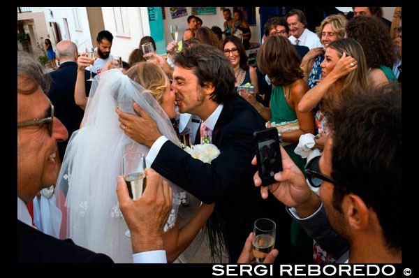 Weedding in Sant Francesc. Church in main square of Sant Francesc Xavier, San Francisco Javier, Formentera, Pityuses, Balearic Islands, Spain, Europe.  Spain; Formentera; island; balearic; Sant Francesc; Xavier; wedding; married; just; love; kiss; kissing; church; guests; romantic; churches; boyfriend; girlfriend; San Francisco; night; Francisco; Javier; main; square; central; typical; religion; constitution; square; white; houses; house; buildings; constitucio; tourists; nice; town hall; day; daylight; daytime; during; europe; european; exterior; exteriors; formentera; holiday; holidays; island; islands; javier; journey; outdoor; photo; photos; pityuses; place; places; san; sant; shot; shots; small; south; southern; spain; spanish; square; squares; tourism; tourists; town; towns; travel; travelling; travels; trip; trips; vacation; vacations; village; villages; Baleares; atrraction; destination; Europe; European; holiday; travel; islands; mediterranean; photos; place; spanish; sun; tourism; touristic; vacation; view; Balearics; beautiful; beauty; paradise; fun; happy; coastal; paradisiac; popular