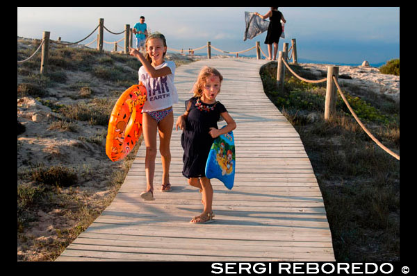 Sa Roqueta Beach and Ses Illetes Beach, Balearic Islands, Formentera, Spain. Funy girls with floats. Spain; Formentera; island; Ses Illetes; beach; sa roqueta; illetes; roqueta; coastline; marine; scene; outdors; girls; children; floats; waterwings; surf; smile; sand; summer; balearic; nice; sea; boats; pretty; beauty; calo; beach; beautiful; beauty; blue; coast; europe; holiday; idyllic; isla; island; islands; islet; landmark; landscape; mediterranean; nature; ocean; outdoor; paradise; places; rock; rocky; san; scenic; sea; seascape; shallow; shore; sky; spain; stones; holiday; horizon; islands; length; look; med; mediterranean europe; platge; platja; playa; rear; rocks; rocky; rough; sand; sandy; sea; single; slim; spain; spanish; stand; summer; tourism; travel; vacation; view; watch; wave; sun; sunny; touristic; transparent; travel; turquoise; vacation; water; waves; white; balearic; Baleares; atrraction; destination; Europe; European; holiday; travel; islands; mediterranean; photos; place; spanish; sun; tourism; touristic; vacation; view; Balearics; beautiful; beauty; paradise; fun; happy; coastal; paradisiac; popular