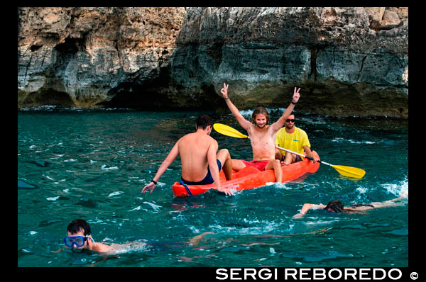 Friends doing kayaking on Cala Sahona, Formentera, Balearics Islands, Spain. Barbaria Cape. Spain; Formentera; kayak; kayaking; tradictional; beach; sea; Cala Sahona; Sahona; inlet; beautiful; friends; blue; people; clear; coast; coastline; crystalline; active; tourism; funny; happy; els; fishing; formentera; holiday; ibiza; idyllic; island; islands; landmark; landscape; mediterranean; nature; ocean; outdoor; paradise; pier; places; port; pujols; rail; railway; rock; scenic; sea; seascape; spain; stranded; summer; sunny; touristic; traditional; transparent; travel; turquoise; typical; vacation; water; white; wooden; island; balearic; Baleares; atrraction; destination; Europe; European; holiday; travel; islands; mediterranean; photos; place; spanish; sun; tourism; touristic; vacation; view; Balearics; beautiful; beauty; paradise; fun; happy; coastal; paradisiac; popular