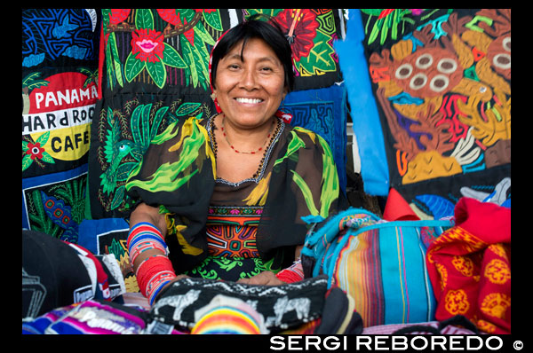 Kuna women sell their molas to the tourists. Panama City Casco Viejo kuna indian traditional handicraft items sellers by kuna tribe.  Old Quarter, Panama City, Republic of Panama, Central America. In Balboa, on Avenida Arnulfo Arias Madrid and Amador, is a small YMCA Handicrafts Market, with mostly Kuna and Emberá indigenous arts and crafts, and clothing. Old Artesanal YMCA Go for: native handicrafts, molas bags, shirts, glasses cases, and pot holders, embroidered blouses, jewellery, hand-woven hats, work by Emberá and Wounaan Indians of the Darién province. Address : Av. Arnulfo Arias and Av. Amador, Balboa, Panama City, Panama