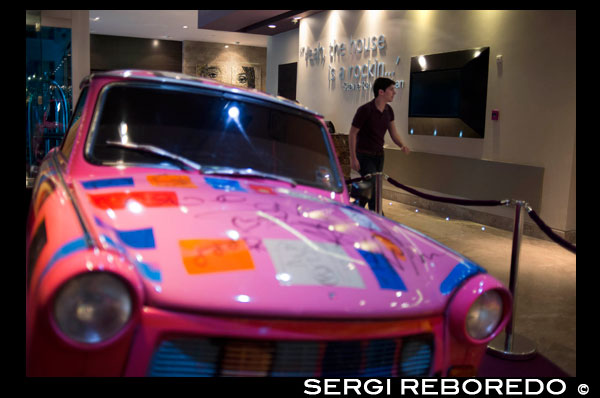 Pink car at lobby of HARD ROCK HOTEL PANAMA MEGAPOLIS. In the heart of Panama rises the new Hard Rock Hotel Panama Megapolis. This spectacular sixty-six story tower beckons you to come and experience where rock star service meets urban chic design – all infused with the passion and irreverence of rock 'n' roll. Located just a few miles from the Panama Canal, this Hard Rock Hotel puts you center stage with breathtaking panoramic views of the city and the Panama Bay.  Live like a true rock star in one of our 1,463 stylish rooms and suites, then come experience our eleven exciting bars, four tantalizing restaurants, and our stellar nightclub. Relax in our Rock Spa, soak in the sun at our infinity pool cabanas, or take fun to new heights at our outdoor rooftop lounge. The hotel is just steps away from MultiCentro Mall and Majestic Casino, offering amazing shopping, restaurants, bars, convention center, and Movie Theater.  Latin America's hottest destination just got hotter with the unveiling of the eagerly anticipated Hard Rock Hotel Panama Megapolis. Located in the heart of Panama City, this awe-inspiring 66 story tower encapsulates the true rock star experience with luxurious touches that will leave you wanting more. Enjoy the decadence of 1,500 stylish rooms and suites, experience tantalizing nightlife and dining options, or turn up the volume poolside with breathtaking views of the city and Panama Bay. It's the perfect combination of Rock 'n' Roll irreverence and urban chic design.