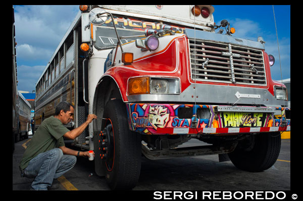 "Decorating a BUS RED DEVIL DIABLO ROJO PAINTED BUS PANAMA CITY REPUBLIC OF PANAMA. Albrok bus station terminal. Panama. Here comes the Diablo Rojo, the Red Devil bus blasting its air horn and fishtailing around a fellow ""demon"" just in time to claim Irma Betancourt and other morning commuters. Suffice it to say the Red Devils earn their name. ""They are crazy,"" said Ms. Betancourt, 33, a housekeeper at a downtown hotel, boarding on a main boulevard. ""We all know that. All they care about is getting the fare. So many times we have almost hit somebody.""  Wandering around Panama City it's hard to miss these crazy fuckin buses rolling around the city. Converted school buses are used as inexpensive public transportation. Each bus in the city is individually decorated which makes an interesting catch whenever rolling around. The average cost to ride one of these buses is 25 cents!  ""Almost"" may make her bus one of the lucky ones, as they are known to have taken more than a few souls for the sake of a pickup.  Her bus on a recent morning is like hundreds of others, a converted, cast-off American school bus ablaze with color, usually heavy on the red.  As if painted by a graffiti artist addicted to action movies and sports, they often boast fanciful, dreamy scenes, including, improbably, a looming Dumbledore from the Harry Potter movies glaring at Ms. Betancourt as she climbs aboard.  Reggaetón, salsa and other bass-heavy music concuss the air, to attract riders to the privately owned buses. Growling mufflers contribute to the soundtrack of the streets. And no self-respecting grille lacks a wild string of Christmas lights.  Typical fare: 25 cents.  ""They evolved into the most visually dominant aspect of Panama City,"" said Peter Szok, a professor at Texas Christian University in Fort Worth who has studied the buses and the folk art of Panama.  It is a tradition elsewhere in the region as well, in other Panama cities as well as in countries like Suriname, where the buses are adorned with politically tinged portraits of heroes and outlaws. But here, at least, the ride is coming to an end.  The buses, many of them retired from Florida schools, have been the backbone of public transit here for more than four decades, with the tradition of decorating vehicles used for public transportation going back even further. Mr. Szok traces the art form to a desire to reflect Latin music styles and an idealized life.  Panama City, however, is rapidly modernizing, with a towering skyline and sprawling shopping malls that promoters hope will put it on the map as another Singapore.  With that has come a push for order. A subway is being dug. Roadways are being built or planned. The Red Devils, owned and operated by their drivers with no real set schedule, are being phased out in favor of something decidedly more vanilla and benign, a Metro Bus system with generic boxy white vehicles familiar in any cities. The only dash of a color is an orange slash.  ""Safe, comfortable, reliable,"" is the slogan. There is even a route map.  President Ricardo Martinelli, whose administration has championed the new system, has pointed to the new buses as a sign of progress, blaming the Red Devils for accidents and accusing them of unreliable service.  ""They will race from one end of the city to the other, killing people, killing themselves,"" he said in a speech in Washington in April. ""Yeah, a lot of people were killed.""  But the Metro Buses, too, are drawing complaints, mainly for slow service. The 25-cent fare on most routes is expected to rise to 45 cents next year, and is already drawing grimaces. Some have taken to calling them the Diablos Blancos, the White Devils.  ""Hey! The line starts back there,"" several people shouted at one crowded downtown Metro Bus stop as their ride finally arrived in a downpour.  ""Look at this long line and little bus shelter,"" said David Polo, 33, who had been waiting for more than 20 minutes. ""The new buses may be safer, but they need more of them.""  Panama's transportation officials said the Red Devils, numbering about 1,200 in recent years, would be gone by the end of this year, but the plan has been delayed more than once as the new system seeks to hire and train drivers.  As the Red Devils disappear — some of them, in the ultimate twist of fate, converted back to school buses, and others dismantled for scrap or sitting in bus boneyards — something a bit unexpected has emerged.  Sympathy for the Red Devils.  The nostalgia ranges from the tongue in cheek — a ""Save the Diablo Rojo"" YouTube video purports to mourn the end of tourists' losing their wallets, among other things, on them — to genuine regrets.  ""It is a loss of part of our culture,"" said Analida Galindo, a co-director of the Diablo Rosso art gallery in the historic Casco Viejo neighborhood. Yes, the gallery name is a play on the Red Devils' name.  The gallery sells bus doors painted by one of the more prolific Red Devil artists, Oscar Melgar, for $2,500 (no takers yet).  Mr. Szok said the painters were largely self-taught, many of them the sons of West Indian immigrants, though some in later years had gone to art school. They typically charged $2,000 and up to paint the buses, meaning some are a kaleidoscope of images while, in others, the yellow has been barely painted over, depending on the wherewithal of the driver.  ""It was a great tradition that people are going to miss,"" said one of the painters, Ramón Enrique Hormi, known as Monchi. ""Here it is Christmastime, and what am I going to do? I have nothing.""  Some owners, too, have complained that the $25,000 that the government is offering them in compensation for giving up their buses may sound generous but will not carry them very far.  Several drivers said they could not get jobs with Metro Bus because of their poor driving records, though the new system has hired many Red Devil drivers.  Other drivers said they had long held second jobs and would find other work.  ""Everything has to come to an end someday,"" one driver, Juan Estanciola, said on a recent day outside his modestly painted bus, which is mostly white with purple trim and bears sayings like ""Don't let my presence mess with your mind.""  He spoke at the door of his bus, which had just collided with a taxi on a rainy afternoon.  ""It was his fault,"" he said. ""He cut in front of me. They don't know how to drive."""