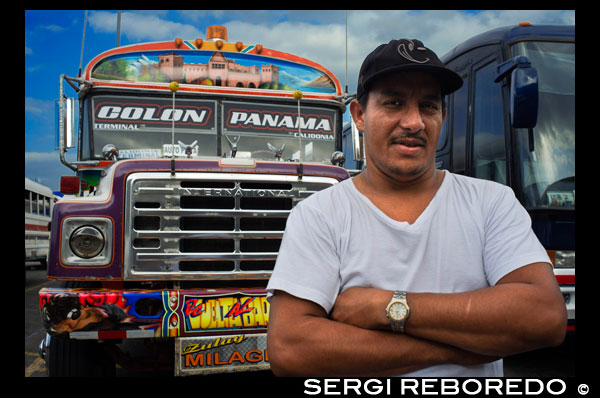 "Driver of BUS RED DEVIL DIABLO ROJO PAINTED BUS PANAMA CITY REPUBLIC OF PANAMA. Albrok bus station terminal. Panama. Here comes the Diablo Rojo, the Red Devil bus blasting its air horn and fishtailing around a fellow ""demon"" just in time to claim Irma Betancourt and other morning commuters. Suffice it to say the Red Devils earn their name. ""They are crazy,"" said Ms. Betancourt, 33, a housekeeper at a downtown hotel, boarding on a main boulevard. ""We all know that. All they care about is getting the fare. So many times we have almost hit somebody.""  Wandering around Panama City it's hard to miss these crazy fuckin buses rolling around the city. Converted school buses are used as inexpensive public transportation. Each bus in the city is individually decorated which makes an interesting catch whenever rolling around. The average cost to ride one of these buses is 25 cents!  ""Almost"" may make her bus one of the lucky ones, as they are known to have taken more than a few souls for the sake of a pickup.  Her bus on a recent morning is like hundreds of others, a converted, cast-off American school bus ablaze with color, usually heavy on the red.  As if painted by a graffiti artist addicted to action movies and sports, they often boast fanciful, dreamy scenes, including, improbably, a looming Dumbledore from the Harry Potter movies glaring at Ms. Betancourt as she climbs aboard.  Reggaetón, salsa and other bass-heavy music concuss the air, to attract riders to the privately owned buses. Growling mufflers contribute to the soundtrack of the streets. And no self-respecting grille lacks a wild string of Christmas lights.  Typical fare: 25 cents.  ""They evolved into the most visually dominant aspect of Panama City,"" said Peter Szok, a professor at Texas Christian University in Fort Worth who has studied the buses and the folk art of Panama.  It is a tradition elsewhere in the region as well, in other Panama cities as well as in countries like Suriname, where the buses are adorned with politically tinged portraits of heroes and outlaws. But here, at least, the ride is coming to an end.  The buses, many of them retired from Florida schools, have been the backbone of public transit here for more than four decades, with the tradition of decorating vehicles used for public transportation going back even further. Mr. Szok traces the art form to a desire to reflect Latin music styles and an idealized life.  Panama City, however, is rapidly modernizing, with a towering skyline and sprawling shopping malls that promoters hope will put it on the map as another Singapore.  With that has come a push for order. A subway is being dug. Roadways are being built or planned. The Red Devils, owned and operated by their drivers with no real set schedule, are being phased out in favor of something decidedly more vanilla and benign, a Metro Bus system with generic boxy white vehicles familiar in any cities. The only dash of a color is an orange slash.  ""Safe, comfortable, reliable,"" is the slogan. There is even a route map.  President Ricardo Martinelli, whose administration has championed the new system, has pointed to the new buses as a sign of progress, blaming the Red Devils for accidents and accusing them of unreliable service.  ""They will race from one end of the city to the other, killing people, killing themselves,"" he said in a speech in Washington in April. ""Yeah, a lot of people were killed.""  But the Metro Buses, too, are drawing complaints, mainly for slow service. The 25-cent fare on most routes is expected to rise to 45 cents next year, and is already drawing grimaces. Some have taken to calling them the Diablos Blancos, the White Devils.  ""Hey! The line starts back there,"" several people shouted at one crowded downtown Metro Bus stop as their ride finally arrived in a downpour.  ""Look at this long line and little bus shelter,"" said David Polo, 33, who had been waiting for more than 20 minutes. ""The new buses may be safer, but they need more of them.""  Panama's transportation officials said the Red Devils, numbering about 1,200 in recent years, would be gone by the end of this year, but the plan has been delayed more than once as the new system seeks to hire and train drivers.  As the Red Devils disappear — some of them, in the ultimate twist of fate, converted back to school buses, and others dismantled for scrap or sitting in bus boneyards — something a bit unexpected has emerged.  Sympathy for the Red Devils.  The nostalgia ranges from the tongue in cheek — a ""Save the Diablo Rojo"" YouTube video purports to mourn the end of tourists' losing their wallets, among other things, on them — to genuine regrets.  ""It is a loss of part of our culture,"" said Analida Galindo, a co-director of the Diablo Rosso art gallery in the historic Casco Viejo neighborhood. Yes, the gallery name is a play on the Red Devils' name.  The gallery sells bus doors painted by one of the more prolific Red Devil artists, Oscar Melgar, for $2,500 (no takers yet).  Mr. Szok said the painters were largely self-taught, many of them the sons of West Indian immigrants, though some in later years had gone to art school. They typically charged $2,000 and up to paint the buses, meaning some are a kaleidoscope of images while, in others, the yellow has been barely painted over, depending on the wherewithal of the driver.  ""It was a great tradition that people are going to miss,"" said one of the painters, Ramón Enrique Hormi, known as Monchi. ""Here it is Christmastime, and what am I going to do? I have nothing.""  Some owners, too, have complained that the $25,000 that the government is offering them in compensation for giving up their buses may sound generous but will not carry them very far.  Several drivers said they could not get jobs with Metro Bus because of their poor driving records, though the new system has hired many Red Devil drivers.  Other drivers said they had long held second jobs and would find other work.  ""Everything has to come to an end someday,"" one driver, Juan Estanciola, said on a recent day outside his modestly painted bus, which is mostly white with purple trim and bears sayings like ""Don't let my presence mess with your mind.""  He spoke at the door of his bus, which had just collided with a taxi on a rainy afternoon.  ""It was his fault,"" he said. ""He cut in front of me. They don't know how to drive."""