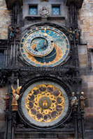 "The Astronomical Clock in Prague (Czech Starom? Stský orloj) is a medieval astronomical clock located in Prague, the capital of the Czech Republic, situated in 50 ° 5'13 .23 ""N 14 ° 25'15 .30"" E. The clock is located in the southern wall of Old Town City Hall in Prague, being a popular tourist attraction. The three main components of the clock are: the astronomical dial, besides indicating that 24 hours a day, representing the positions of the sun and moon in the sky, and other details astronomical animated figures including ""Ride of the Apostles "", a clockwork showing, when the clock strikes the hour, the figures of the Twelve Apostles."