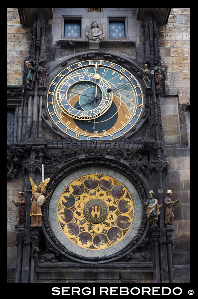 "The Astronomical Clock in Prague (Czech Starom? Stský orloj) is a medieval astronomical clock located in Prague, the capital of the Czech Republic, situated in 50 ° 5'13 .23 ""N 14 ° 25'15 .30"" E. The clock is located in the southern wall of Old Town City Hall in Prague, being a popular tourist attraction. The three main components of the clock are: the astronomical dial, besides indicating that 24 hours a day, representing the positions of the sun and moon in the sky, and other details astronomical animated figures including ""Ride of the Apostles "", a clockwork showing, when the clock strikes the hour, the figures of the Twelve Apostles. The circular calendar with medallions representing the months of the year.The astronomical dial shaped astrolabe, an instrument used in medieval astronomy and navigation to the invention of the sextant. He has painted on her representations of the earth and the sky and the surrounding elements, especially of four main components: the zodiacal ring, rotating ring, the icon representing the sun and the icon representing the Moon . The background represents the Earth and the local view of the sky. The blue circle in the center represents our planet and the darker blue the sky view from the horizon. The red and black areas indicate parts of the sky that are on the horizon. During the day the sun stands in the background blue, while the evening comes to lie in the dark. From dawn to dusk, the mechanical sun makes is always positioned on the red zone. To the left of the clock (East), we find the dawn and sunrise, while in the west we find the sunset and twilight. Astronomical Quadrant. The blue circle golden numbers represent 24 hours a day (standard format), marking Prague civil time. But we also find 12-hour division, defined by the time between sunrise and sunset and duration varies by day depending on the season...."