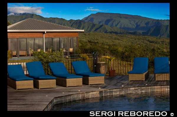 Hotel pool and exterior Diana Dea Lodge. Located 600m, overlooking the village of Sainte Anne, Diana Dea sleek, modern aesthetics and the amazing scenery it apart as a place a bit special. Surrounded by endless expanse of lush green land, toward Diana Dea can feel like you're far away from home ... in the best possible way. With a small selection of individually styled rooms and suites spread over the hills of the countryside of the island of Reunion, this is the perfect place to relax in a hammock and enjoy the serenity. LOCATION A little French soil slither through the Indian Ocean, Reunion Island offers every environment you can imagine. Sandwiched between Madagascar and Mauritius, you will find everything from thick rainforest to vast coastal lowlands, freely flowing waterfalls and volcanic peaks. Built on land once reserved for hunting, a stroll through the gardens of the hotel will take you through vast stretches of wild forest inhabited by a small community of wild deer. THE ROOM Furnished with dark woods, stone cold and an eclectic range of fabrics, the suites here are all about texture. Brightly colored artwork adorn the pastel walls and rustic wooden sculptures sit on coffee tables and in corners in low light. Step out onto your private balcony and drink in the view of 180 degrees or enjoy a similar picture of a tub full of scented bubbles. Why We Like Hiding in the hotel library with a well-thumbed copy of his favorite novel or get in the middle of the antique furniture and cozy fireplaces in the rustic bar and restaurant with a glass of French red wine. Also worth book yourself rather than one or two treatments at the spa for a relaxing massage that will leave you feeling completely relaxed and rejuvenated.