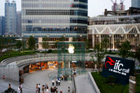 Apple computer store in Lujiazui financial district, in Pudong, in Shanghai, China. View of large modern Apple store in Shanghai China. Apple Store Pudong in front of Shanghai IFC South and North Tower (HSBC building) in Pudong District, Shanghai, China. Shanghai International Finance Centre, usually abbreviated as Shanghai IFC, is a commercial building complex and a shopping centre (branded Shanghai IFC mall) in Shanghai. It incorporates two tower blocks at 249.9 metres (south tower) and 259.9 metres (north tower) housing offices and a hotel, and an 85-metre tall multi-storey building behind and between the two towers.  Shanghai IFC is located in Lujiazui, in Pudong, Shanghai. It occupies a prominent position southeast of the Lujiazui