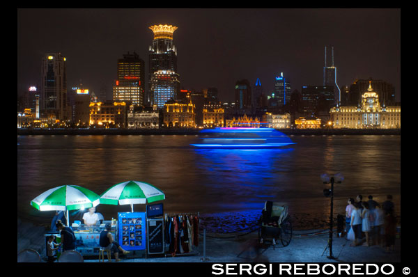 The bund on the night and the Huangpu river. The Bund promenade, Shanghai, China. China Shanghai Tourist Shanghai Skyline viewed over the Huangpu river from the Bund. Bin Jiang Avenue, The Bund, Shanghai, China. The highlights of the Bund are undoubtedly the colonial-era buildings lining the west side of Zhongshan Dong Yi Lu, standouts of which include the former British Consulate, Customs House, former Hong Kong and Shanghai Bank, former Shanghai Club (now the Waldorf Astoria Hotel), and the Peace Hotel. For more details on these buildings, many of which have been skillfully restored, and a more complete walking guide to this gallery of European architecture.  Besides its landmark colonial architecture, however, the Bund has a few other small attractions. On its north end, the rehabilitated Suzhou Creek enters the Huangpu River beneath the 18m-wide (59-ft.) iron Waibaidu Bridge, built in 1906 to replace the original wooden toll bridge constructed in 1856 by an English businessman. The bridge was most recently restored in 2009. On the river shore stands a granite obelisk, Monument to the People's Heroes, erected in 1993, and dedicated to Chinese patriots (as defined by the Communist Party) beginning in the 1840s. The Bund History Museum (9am-4:15pm; free admission), which contains a few artifacts and some interesting photographs of the Bund, stands at its base; however, at press time, the museum was closed for renovation. Just south of the monument used to be the park Huangpu Gongyuan, originally the British Public Gardens built in 1868. In the early days, only Chinese servants accompanying their foreign masters were allowed to enter the park. Dogs were also prohibited, leading in later years to the apocryphal NO CHINESE OR DOGS ALLOWED sign being attributed to the park. The park was eventually opened to Chinese in 1926, but today, has simply become part of the Bund promenade with the recent renovations. South of here, across from the Peace Hotel, is the entrance to the pedestrian Bund Sightseeing Tunnel (Waitan Guanguang Suidao) (daily 8am-10:30pm, 11pm Fri-Sun; admission ¥55 round-trip, ¥45 one-way) located under the Huangpu. Complete with tram cars and a light show, the tunnel connects downtown Shanghai to the Pudong New Area and the Oriental Pearl TV Tower. Also here is a statue of Chen Yi, Shanghai's first mayor after 1949 and a dead ringer for Mao Zedong, at least in bronze.  Farther south down the Bund Promenade are scores of vendors, a few restaurants, and excellent overlooks facing the river. At the intersection with Yan'an Dong Lu, you'll also notice a picturesque Signal Tower, a slender, round brick tower that served as a control tower for river traffic during colonial days. First built in 1884, the tower was rebuilt in 1907, and also relayed weather reports. In 1993 during the widening of Zhongshan Lu, it was moved 20m (66 ft.) to its current site. About a 20-minute walk farther down the promenade are the docks for the Huangpu River cruises.