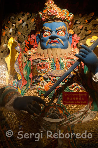 Virudhaka sculpture inside the Jokhang Temple. Virudhaka, guardian of the South is the Lord of the Kumbhandas, faced dwarf buffalo. He is the protector of the Buddha Ratnasambhava, born of a jewel.