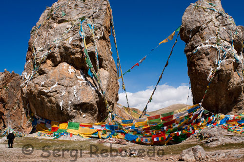 The twin stones Nam-tso Lake, with hundreds of prayer flags. Nam-tso Lake to 4718 m, is another holy lakes in Tibet, and the lake in the world's highest. In this picture it is raining and not appreciated its spectacular beauty.
