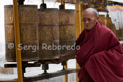 A monk spinning the prayer wheels inside the Tashilumpo Monastery, located in Shigatse, Tibet. Tashilumpo monastery is huge, as befits a building that holds 700 people.