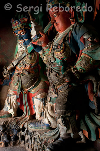 Sculptures by some deities inside the monastery Pelkhor Chode. Gyantse. The monastery is beautiful with its stupa of 9 floors and 108 chapels, but what we liked, is the village life, with its traditional houses and cattle tied in front of each door, as if the watchdog.