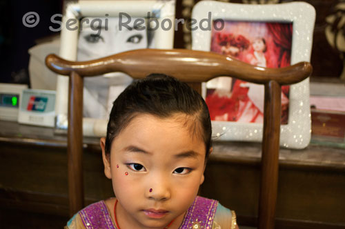 A girl makeup inside a photo studio specializing in weddings in the Muslim Quarter of Xi'an. Xian has a lot to offer besides the Warriors, especially if traveling with children, the fortifications of the city provided for a short bike ride into the city markets, bazaars and alleyways pass very entertaining!