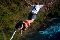 Bungee Jumping at Victoria Falls over Zambezi River. Surely Bungee Jumping 111 meters off the Victoria falls Bridge has to be one of the most challenging, terrifying, crazy things to do. I have not built up the courage yet but from all accounts.... It's a must do. Thanks to Shearwater, a leading adventure company in Zimbabwe, I got the chance to fulfill my bungee destiny by leaping off the Victoria Falls Bridge. The jump takes you head first into the Batoka Gorge, where white-water rafters below try desperately to stay upright as they ride through grade 5 rapids. The Victoria Falls are situated right behind the bridge and you can feel the spray on the bridge when the water is high. The bridge is in no-man's land, marking the border between Zimbabwe and Zambia. It was built in 1905 and is an engineering marvel (that you get lots of time to appreciate once you've been winched back after your jump).