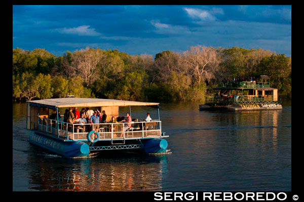 "Cruise along the Victoria Falls aboard the "" African Queen"".  Other boats sailing in the Zambezi River. Victoria Falls is famous for its sunset booze cruises and this is a ""must do"" experience. But you don't have to be an alcohol drinker to enjoy the experience of being on Southern Africa's largest river. You are certain to see hippo and crocs and possibly elephant during the excursions, which last about two hours on average. During the dry season, elephants often swim to the islands to feed and there are a couple of pachyderms that have taken up full-time residence on the island of Kalunda opposite the jetty on the Zimbabwean side of the river. Generally, tour operators arrange for you to be picked up from the hotel, lodge or B&B, and driven to one of the many launch sites along the western bank of the Zambezi. From the Zimbabwe side, the ride out to the boarding points varies depending on where you are staying and how many pick-ups the drivers have to make, but generally the wait is not more than 10 to 15 minutes. From the Zambian side, boats tend to depart from hotel docks."