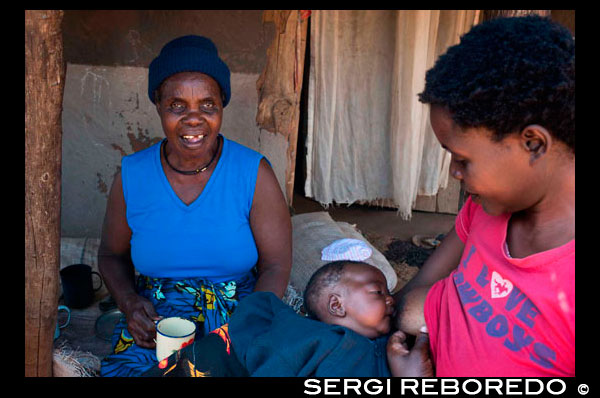 "A woman breastfeeding her son in Mukuni Village. Zambia. Zambia launches campaign to promote exclusive breastfeeding. At the launch of the Government of Zambia's new advocacy campaign for infant and young child feeding, the country's Minister of Health had a clear message for every mother: Exclusively breastfeed your newborn for the child's first six months of life. ""Exclusive breastfeeding means giving the baby only breast milk for the first six months, and no other liquids or solids, not even water unless medically indicated,"" said Minister of Health Kapembwa Simbao. ""It is therefore crucial that breastfeeding our children becomes the norm in Zambia, because breast milk plays a very important role in securing the health of children and is essential for overall child survival."" To help improve the nutritional status of every Zambian child, the ministry's new advocacy campaign is emphasizing the importance of breastfeeding, starting within the first hour of birth and continuing exclusively for the first six months. The national campaign aims to increase the exclusive breastfeeding rate substantially. ""This gathering today is a significant step in Zambia's fight against malnutrition. The launch of the mass media campaign against malnutrition, with a focus on exclusive breastfeeding of children under six months of age, is commendable step by the government and partners to make a difference for these children and to save their lives,"" said UNICEF Deputy Representative in Zambia Elspeth Erickson."