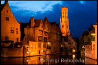 Bruges. Bruges at night with the Belfry in the background, the most tipical landscape in Bruges. Evening view over Bruges : the Dijver canal and the Belfry tower.